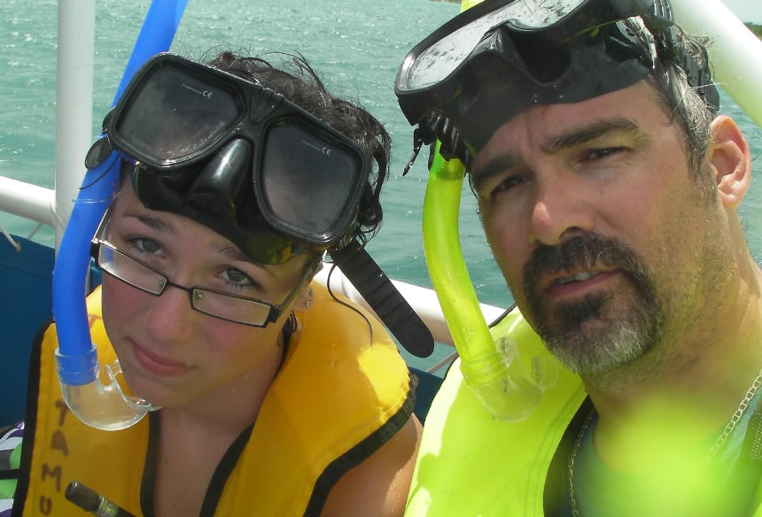 Rehtaeh and Glen in scuba diving gear on a boat.