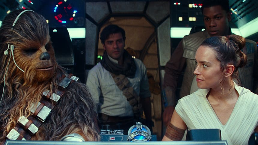 Chewbacka and Rey characters look at each other in the cockpit of the ship.