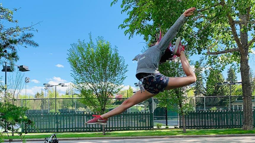 A girl dances in a park