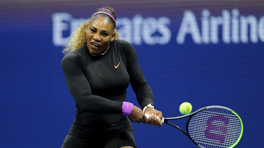A tennis player plays a forehand.