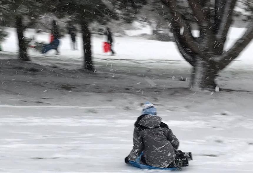 kid from Victoria, B.C., enjoys a toboggan run