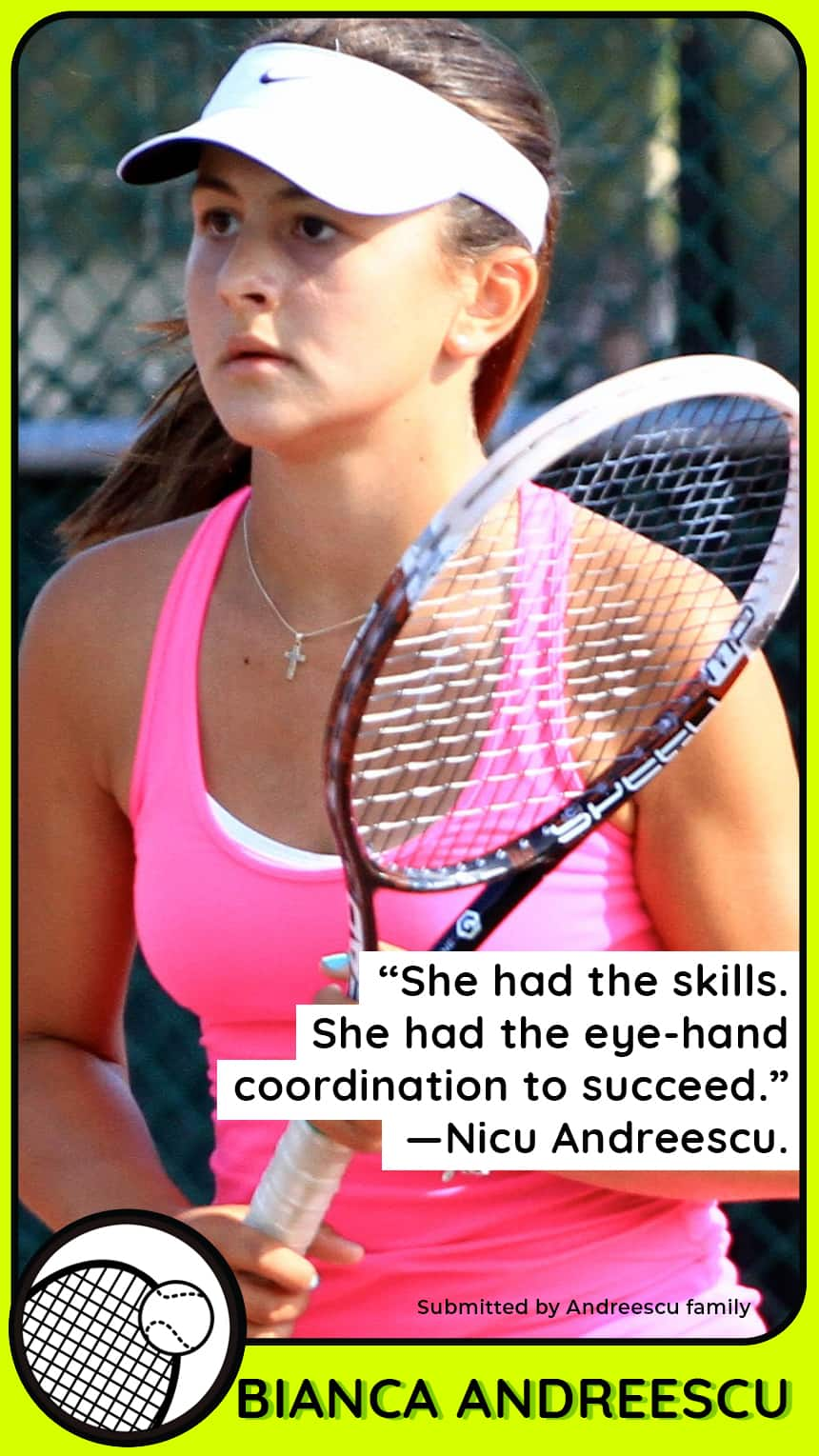 A young female tennis player looks concentrated holding her racquet.