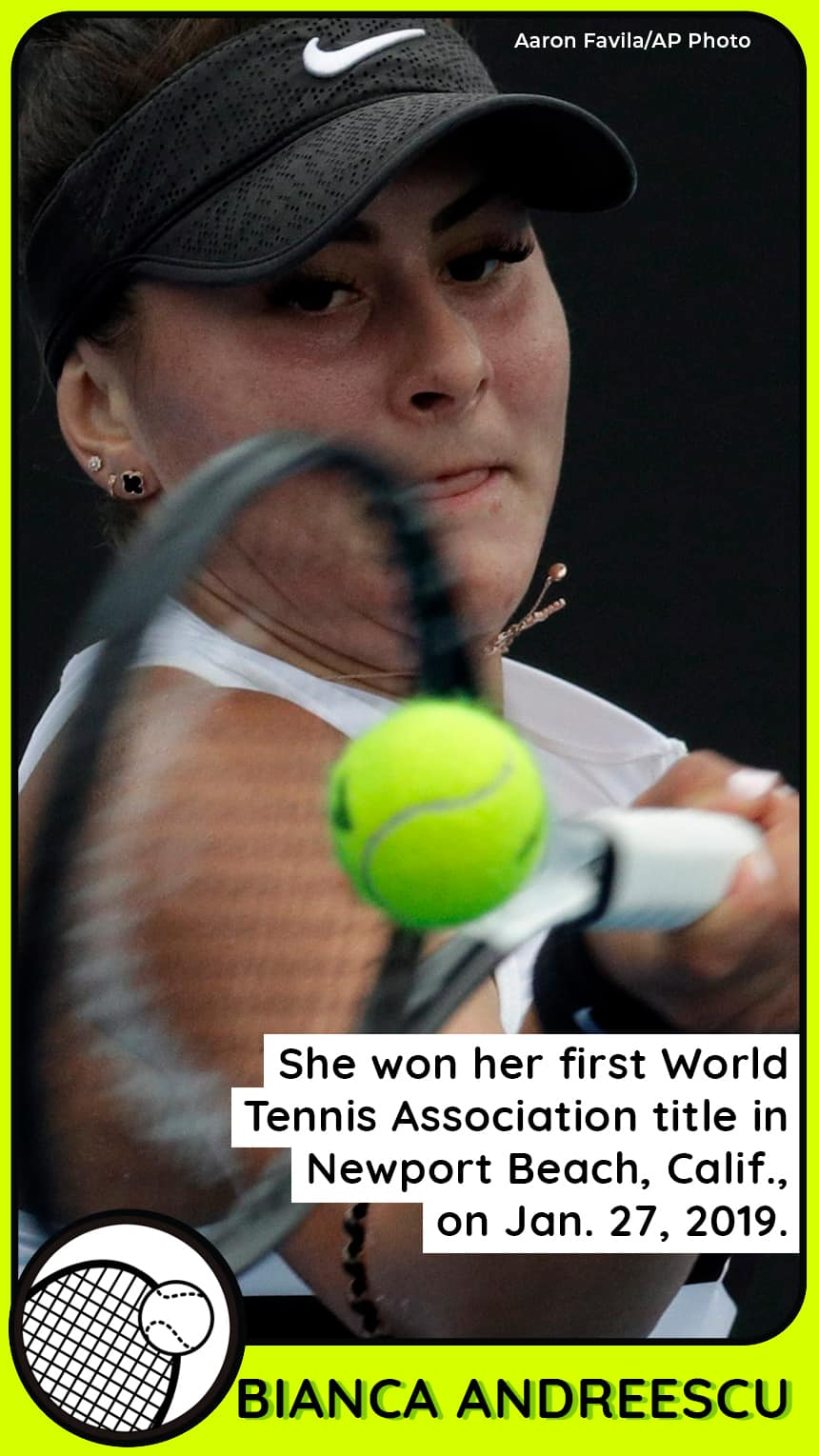 A female tennis player looks focused as she hits the ball.