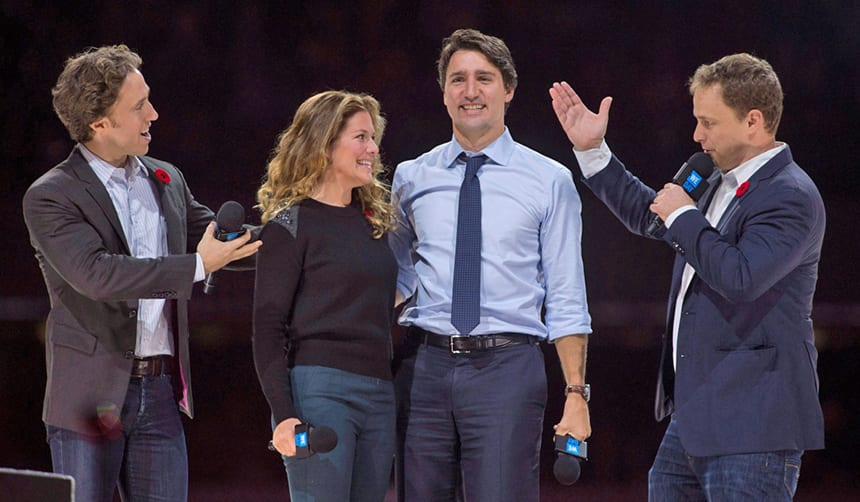 WE Charity co-founders Craig and Marc Kielburger introduce Prime Minister Justin Trudeau and his wife Sophie Gregoire-Trudeau in 2015 as they appear at WE Day celebrations.