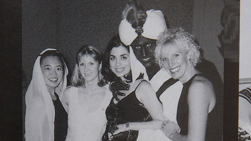 Justin Trudeau with black paint on his skin and a turban on his head.