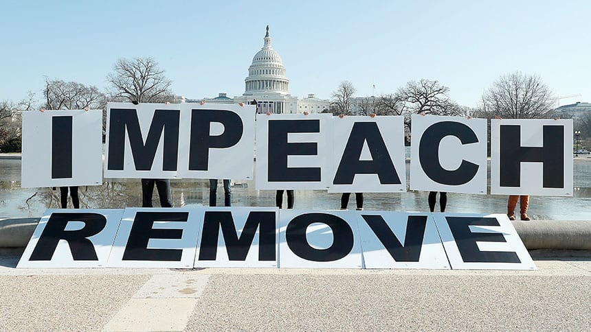 Protesters carry huge signs that say IMPEACH and REMOVE