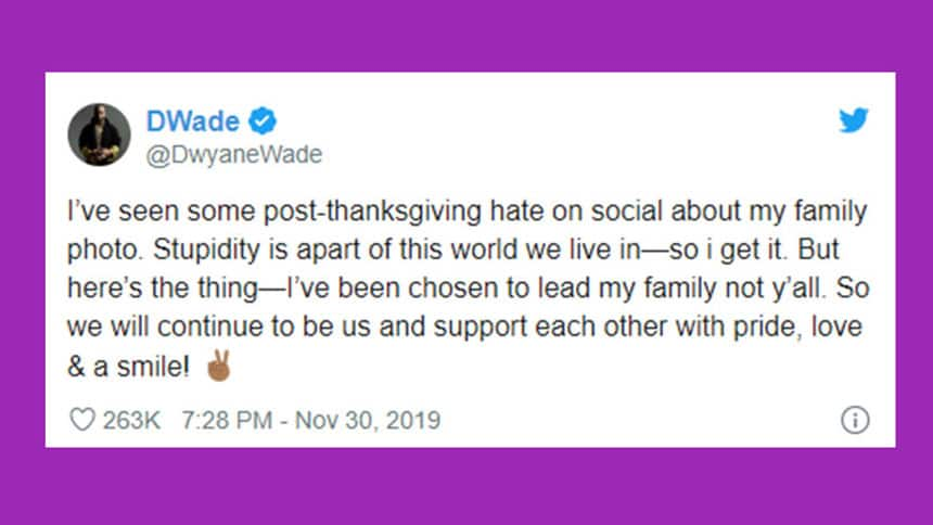 Tweet from Dwayne Wade says I've seen some post-thanksgiving hate on social about my family photo. Stupidity is a part of this world we live in - so I get it. But here's the thing. I've been chosen to lead my family not y'all. So we will continue to be us and support each other with pride love and a smile.