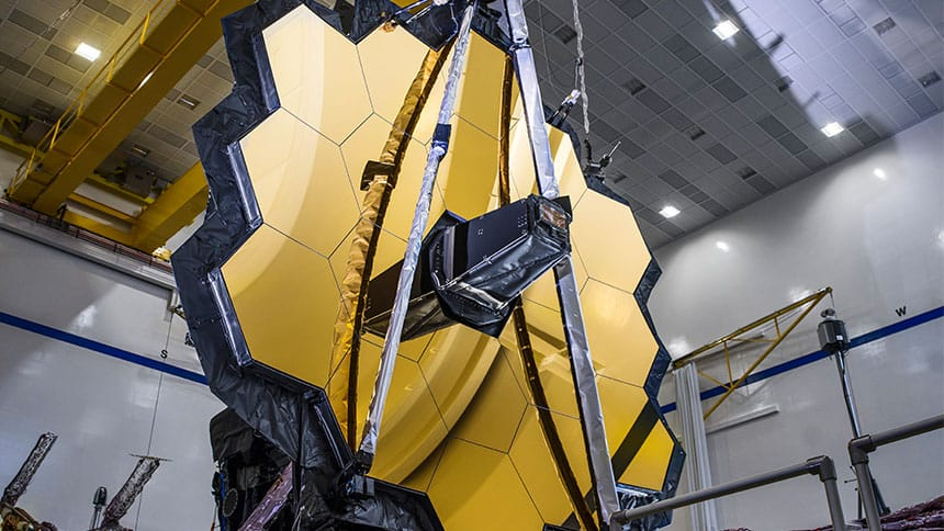 James Webb Telescope with mirrored panels in honeycomb pattern.