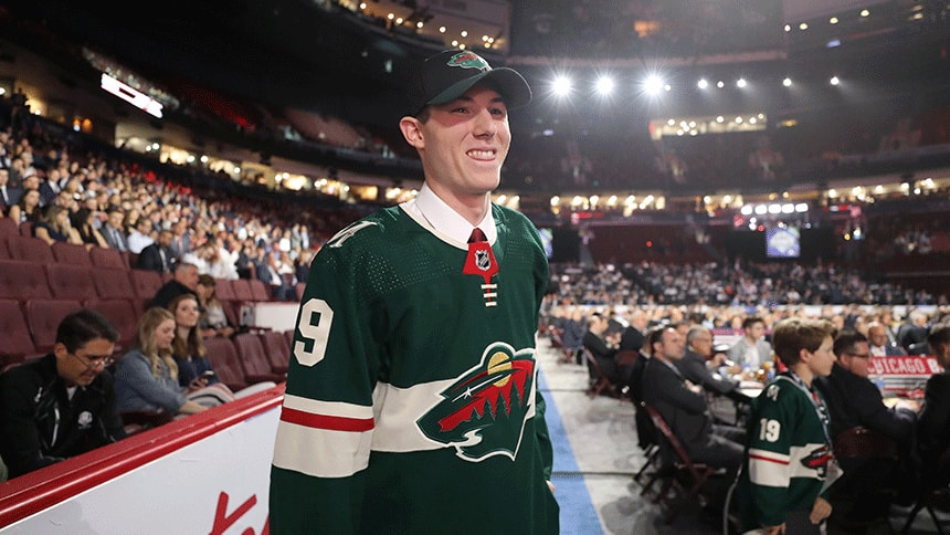 A hockey player smiles at the NHL draft
