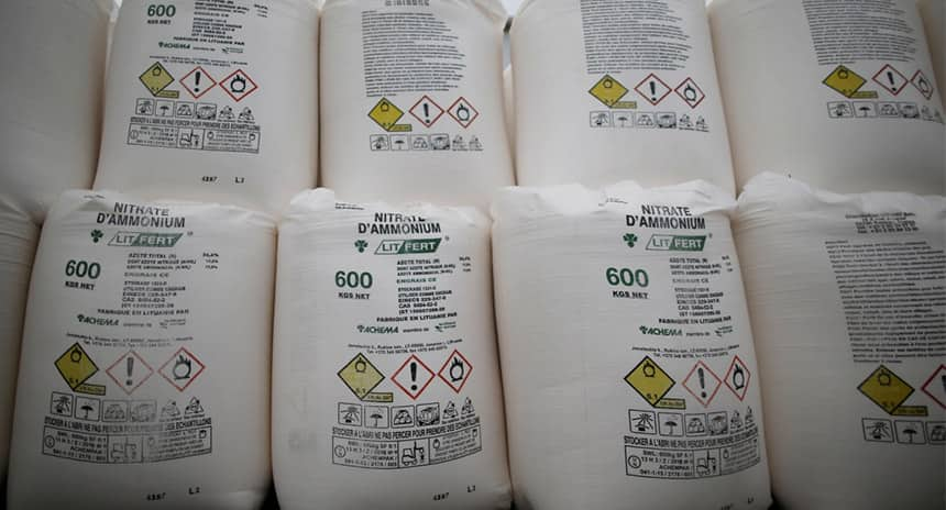 Bags containing ammonium nitrate fertilizer on display.