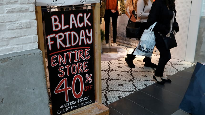 A sign advertises Black Friday sale on the entire store except for some items