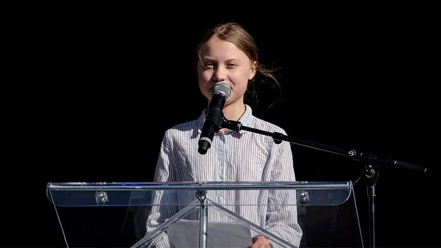Greta Thunberg speaks at a podium