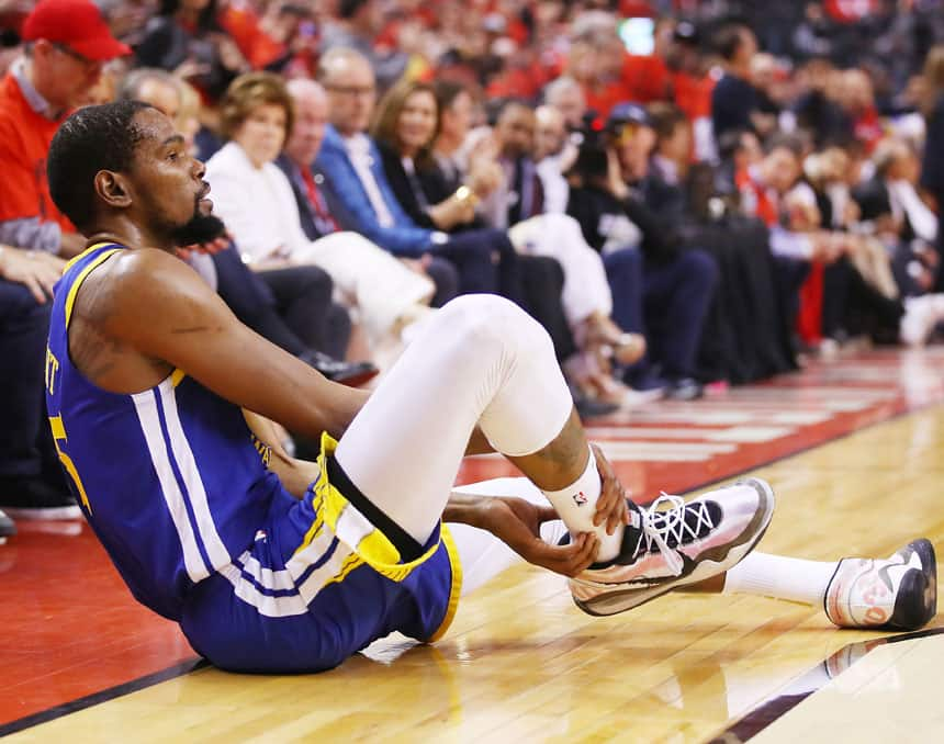 Kevin Durant holds on to his Achilles during Game 5 of the NBA Finals