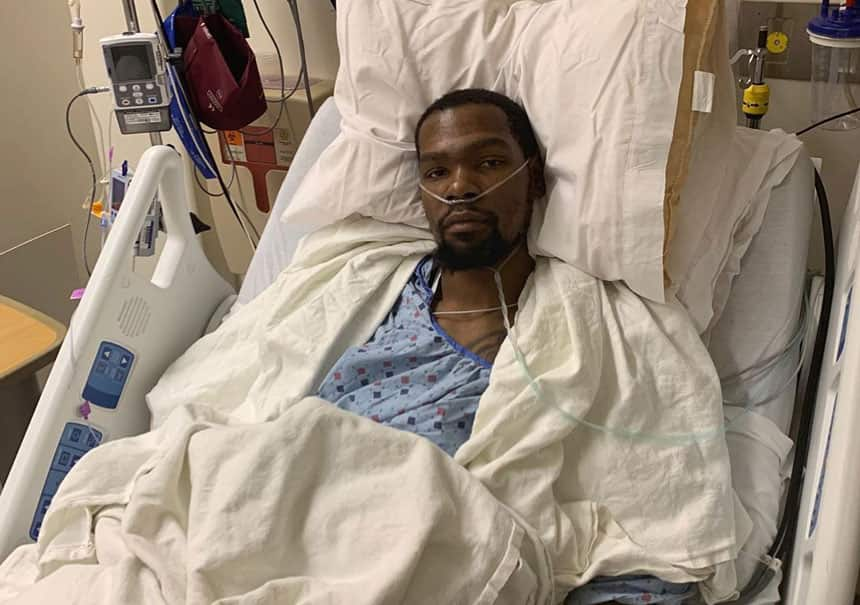 Kevin Durant in a hospital bed after his operation for a ruptured achilles tendon