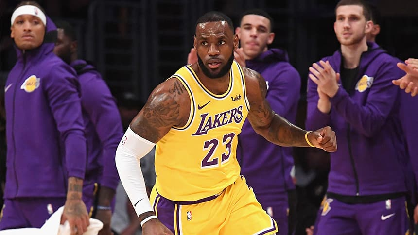 244e1e290dc An intense-looking basketball player is cheered by fellow team-mates. LeBron  James stayed out of ...