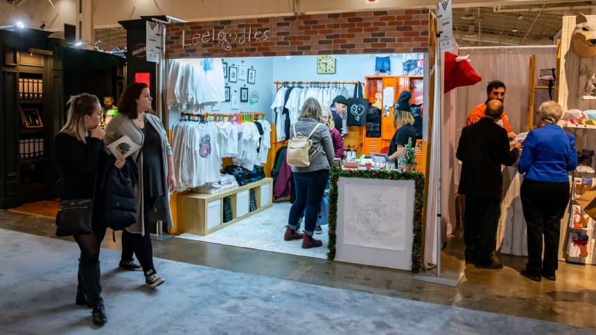 Customers pictured here shopping at the Leeloodles booth at the 2019 winter One of a Kind Trade show.