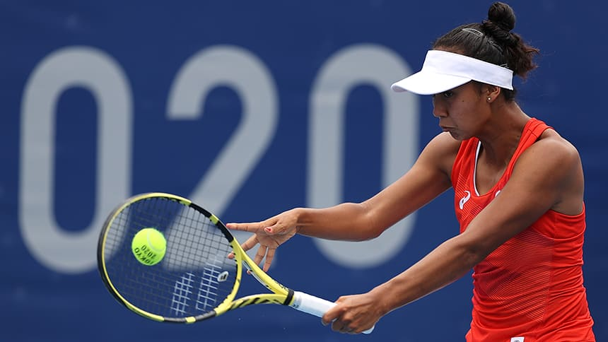 Leylah Fernandez swings a forehand and grimaces at the Tokyo 2020 Olympics.