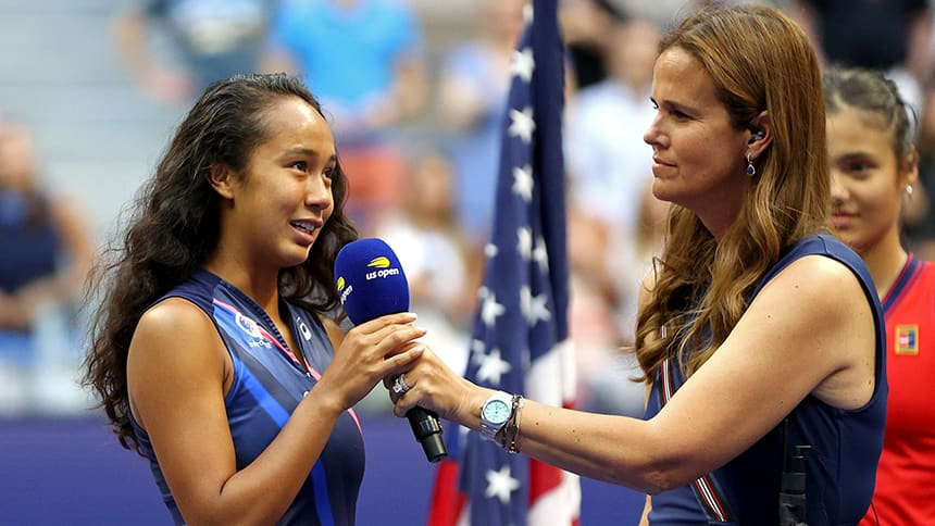 Fernandez holds the microphone as she addresses the crowd post-match.