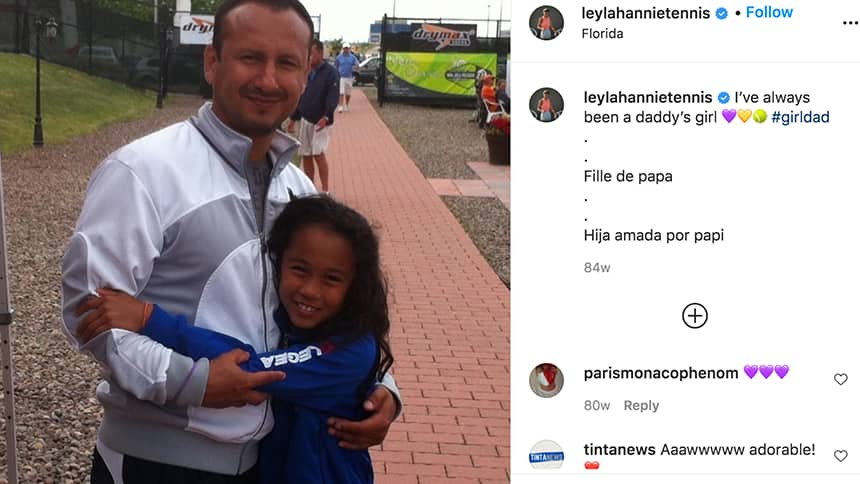 An instagram post of a young Leylah hugging her father.