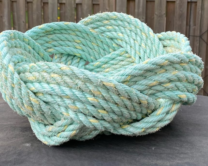 A bowl made from rope that looks almost like an elegant bird's nest
