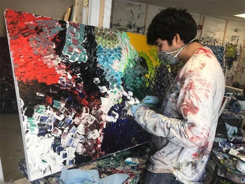 Niam Jain painting in his studio.
