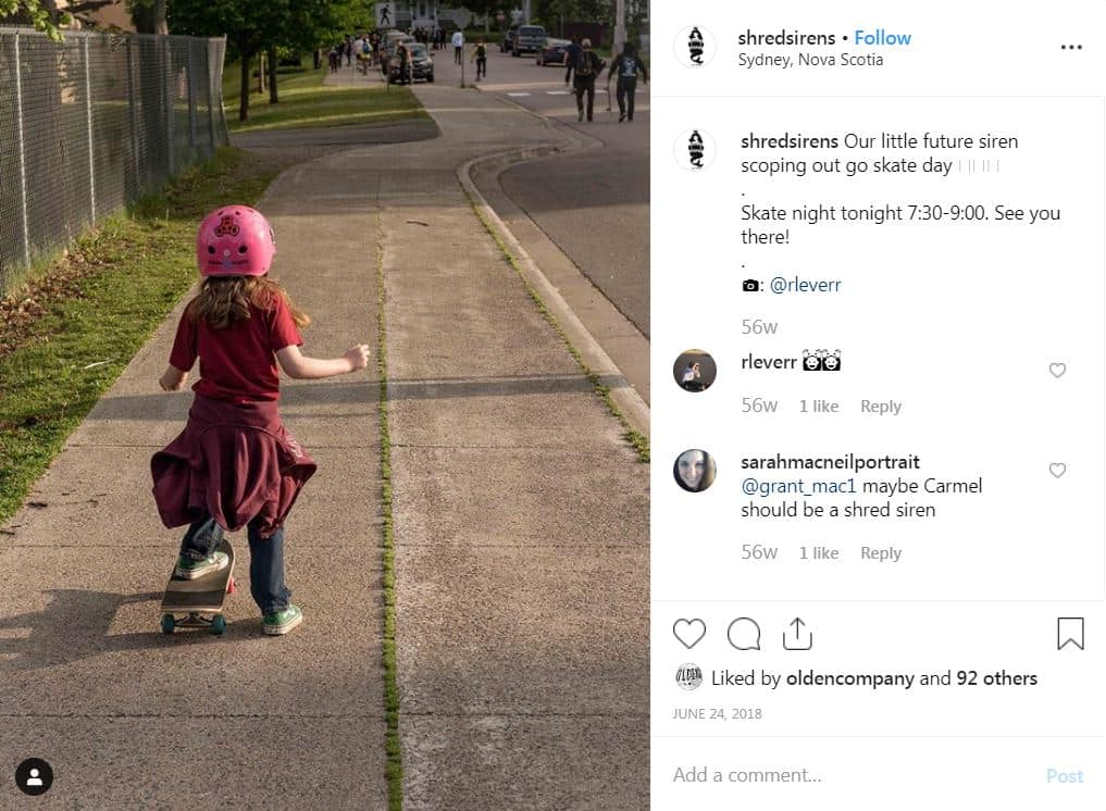 A girl skateboards down the street