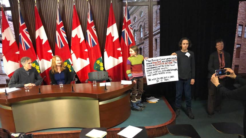 Zoe Keary-Matzner, 12, in the striped sweater, at a Queen's Park press conference