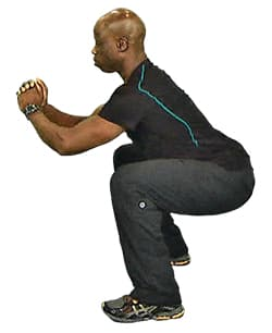 garfield wilson demonstrates a proper squat.jpg