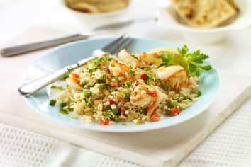Brown Rice Paella with Shrimp and Baby Peas