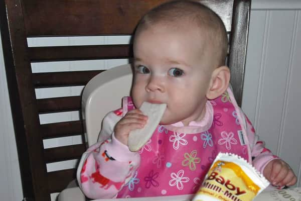 11-month-old Bethany sitting down for family dinner