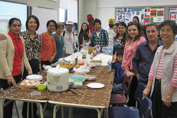 Rebecca MacDonald and friends at a community potluck