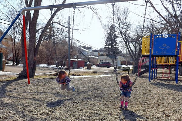 Playing on the swings, photo by Annabel Townsend