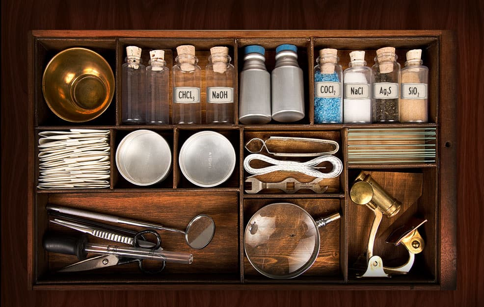 A chemistry kit containing several items, including chemicals such as CHCl3 and NaOH.