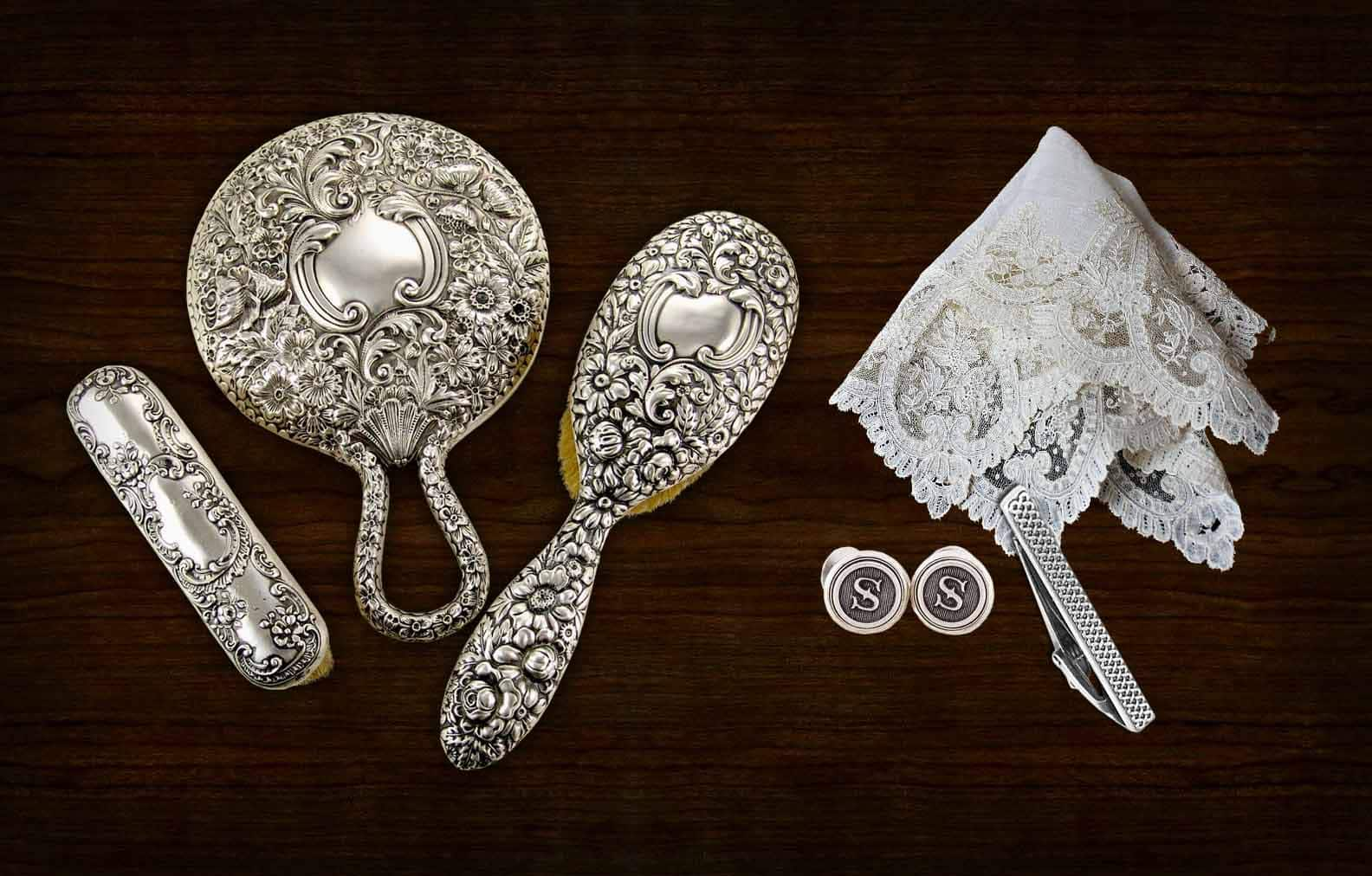 The vanity contains a hairbrush, mirror, handkerchief, cufflinks, and an unbroken tie clip.