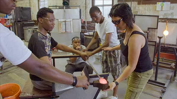 Young people in a glass blowing project