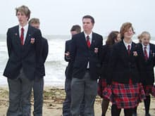 Wind Blown Students Participate In Their Own Memorial Ceremony On Juno Beach On June