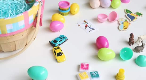 An array of toys, stickers, stamps beside colourful plastic Easter eggs.