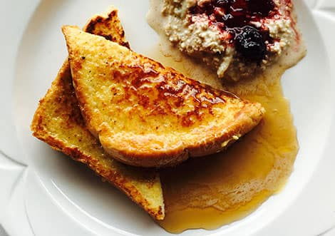 a photo of french toast with maple syrup on it with a side of oatmeal