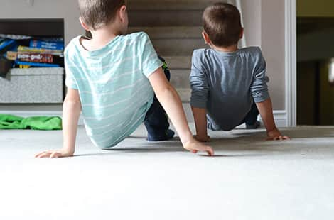 Two kids doing the crab walk.