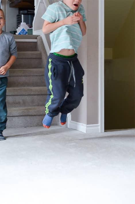 Child jumps like a kangaroo.