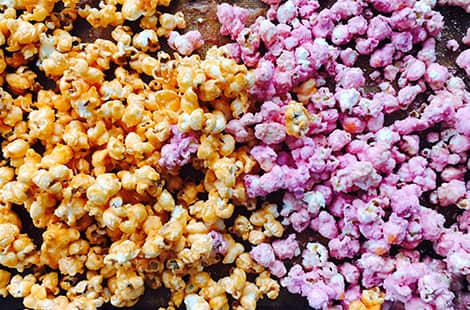Colourful batch of pastel-coloured popcorn.