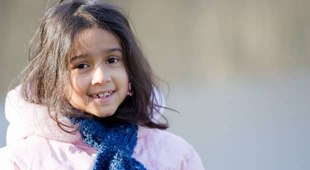 A picture of a young girl with a scarf on.
