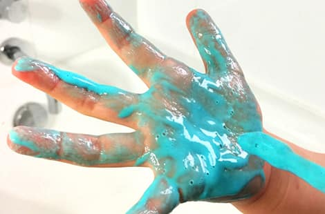 Blue paint on a hand.