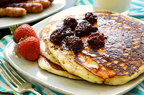 Pancakes with blackberries and syrup on top!