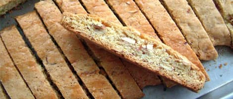 A pile of biscotti on a baking tray.