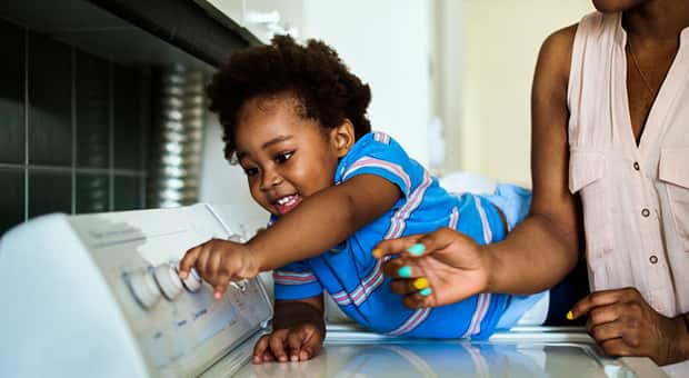 Child helping mother out with laundry