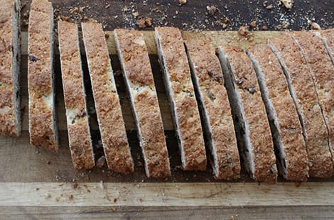 Banana biscotti cut-up on cutting board.