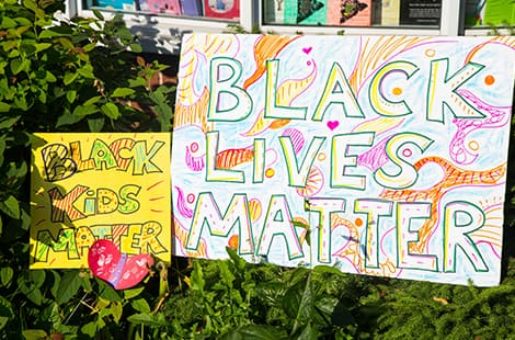 Black Kids Matter and Black Lives Matter posters on display