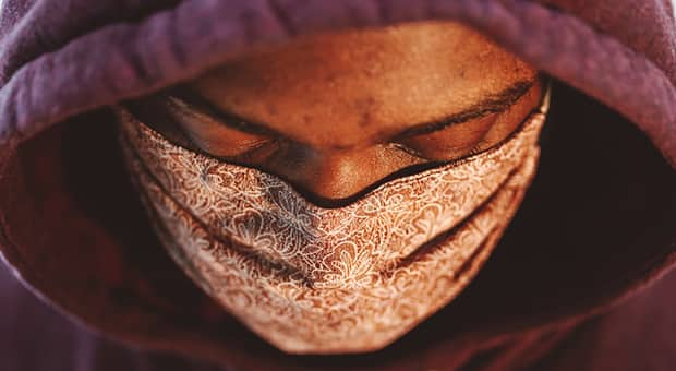 Black man wears floral-patterned mask
