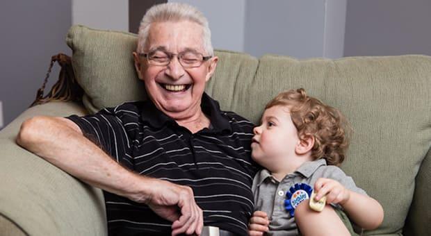 Child sits on grandpa's knee